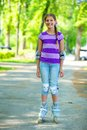 Roller skate girl beautiful in skates at a park Royalty Free Stock Photo