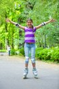Roller skate girl beautiful in skates at a park Stock Photography