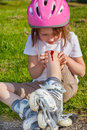 Roller skater with an injured leg unhappy preschool Stock Images