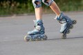 Roller skates on beautiful girls feet Royalty Free Stock Photos