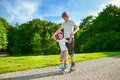 Roller skating father and daughter enjoy Stock Photos