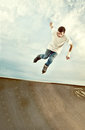 Rollerblade hang time photo of a young boy with roller blades jumping high on the skate ramp frozen in the vintage look to it with Royalty Free Stock Images