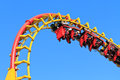 Rollercoaster ride against blue sky Stock Images