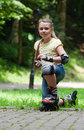 Rollergirl littke roller girl resting on knee between exercises Stock Photography