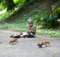 Rollergirl and squirrels cute little girl with roller blade at park Royalty Free Stock Photos
