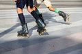Rollers closeup view of two boys skating with rollerblades Royalty Free Stock Images