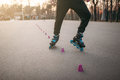 Rollerskater, rollerskating trick exercise in park Royalty Free Stock Photo