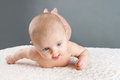 Rolling baby cute trying to roll from belly to back child development concept Royalty Free Stock Photos