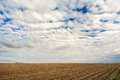 Rolling clouds over an iowa farm field in spring Royalty Free Stock Image