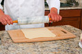 Rolling dough making beef wellington Royalty Free Stock Photos