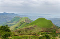 Rolling fertile hills with fields and crops on Ring Road of Cameroon, Africa Royalty Free Stock Photo