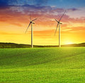Rolling field with wind turbines Royalty Free Stock Photo