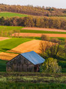 Rolling hills farm fields and a barn in southern york county pa pennsylvania Stock Image
