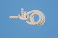 Rolling hitch the or magnus knot is a knot usesd toattach a rope to a rod Royalty Free Stock Image