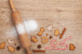 Rolling pin with flour spices and cookies on wooden table view from above Stock Photo