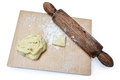Rolling pin and shortcrust wooden board with dough Royalty Free Stock Photography
