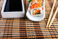 Rolls assortment   with soy sauce on white plates. Royalty Free Stock Photo