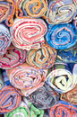 Rolls of colorful fabric selling in market Royalty Free Stock Images