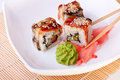 Rolls with eel on a white plate Royalty Free Stock Image