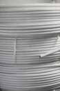 Rolls of electrical cable and conduit close up view three stacked for use in a domestic installation Royalty Free Stock Image