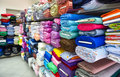 Rolls of fabric and textiles in a factpory shop factory multi different colors patterns on the market Stock Photos