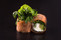 Rolls with greens and salmon