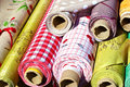Rolls of plastic sided fabric colorful side used as tablecloths Royalty Free Stock Photo