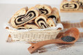 Rolls with poppy seeds bread in a small basket Royalty Free Stock Photography