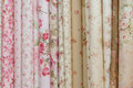 Rolls of romatic flowery printed cloths Royalty Free Stock Images
