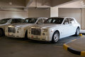 Rolls royce nov abu dhabi uae two white luxury limousines parking at the streets of abu dhabi is a uk luxury car Royalty Free Stock Photography