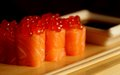 Rolls with salmon and red caviar japanese food Stock Photography