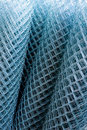 Rolls of shiny new chain link fence Royalty Free Stock Photo
