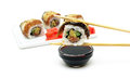 Rolls with smoked eel, avocado and salmon on a white background Royalty Free Stock Photo