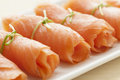 Rolls of smoked salmon as a snack Royalty Free Stock Photo