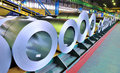 Rolls of steel sheet stored in warehouse Stock Photo