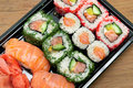 Rolls and sushi on a bamboo board Royalty Free Stock Photo