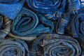 Rols of jeans trousers stucked blue Royalty Free Stock Photos