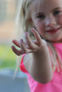 Roly pollie pinky a child with a pill bug poly on her pinkie finger Stock Photo