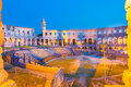 The roman amphitheater of pula croatia shot at dusk it was constructed in ad and is among six largest surviving arenas Royalty Free Stock Photography