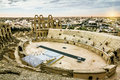 Roman amphitheatre in the city of el jem in tunisia at sunset types amid dramatic sky Royalty Free Stock Image