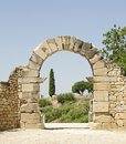 Roman arch an into the ruins at volubilis in morocco the impressive ruins of this regional capital sit surrounded by a mix Stock Images