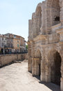 The roman architecture wall of arles amphitheatre with many arches is a great example of Stock Photos