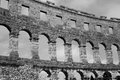 Roman arena in pula croatia dramatic black and white monochrome of the ancient ruins of the amphiitheater this image was taken Royalty Free Stock Image