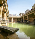 Roman baths hot spring pool bath england april tourists at the bath museum on april in bath the are a major tourist attraction and Stock Photo