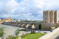 Roman bridge of cordoba is over the guadalquivir river in cordova it was built by the romans in the early st century bc and Stock Photos
