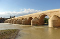 Roman bridge guadalquivir river cordoba spain the great crossing over the the building of the great mosque of you can see in the Royalty Free Stock Photos