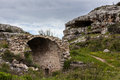 Roman bridge landscape of a gorge in italy these formations are known as gravina with caves and slopes Stock Photos