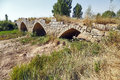 Roman bridge over the river brulles trisla in sasamon burgos spain Royalty Free Stock Images