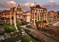 Roman forum foro romano and ruins of septimius severus arch saturn temple at sunset rome italy Royalty Free Stock Photos