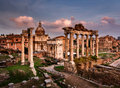 Roman forum foro romano and ruins of septimius severus arch saturn temple at sunset rome italy Royalty Free Stock Images